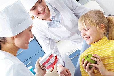 Child Learning About Teeth Cleaning - Pediatric Dentist and Orthodontist in Houston, Pearland and Pasadena, TX